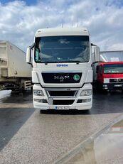 MAN TGX 24.440 camión con lona corredera + remolque con lona corredera
