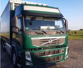 VOLVO FM 380 camión con lona corredera
